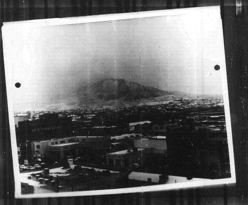 Actual photo of snow storm descending over the Franklin Mountains, taken one hour before the crash from the Downtown Federal Courthouse roof on 11 December 1953 1:30pm