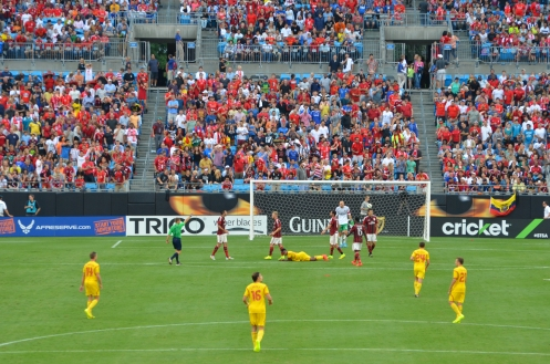 Liverpool FC wearing their away colors, in yellow, against AC Milan in Charlotte, NC on 2 August 2014