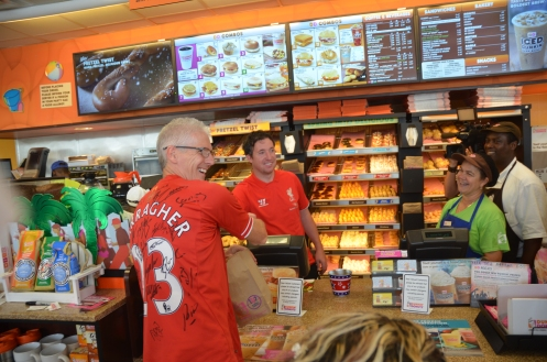 Super Fan, David Cruise, accepting a donut sale from Robbie Fowler