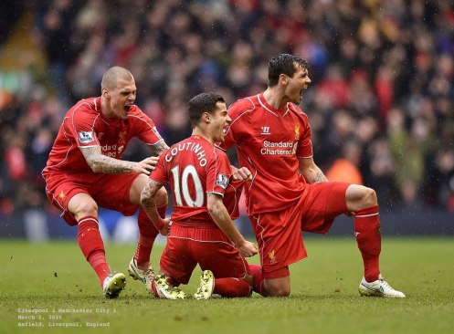 Martin Skrtel, Philippe Coutinho and Dejan Lovren celebrate with passion....